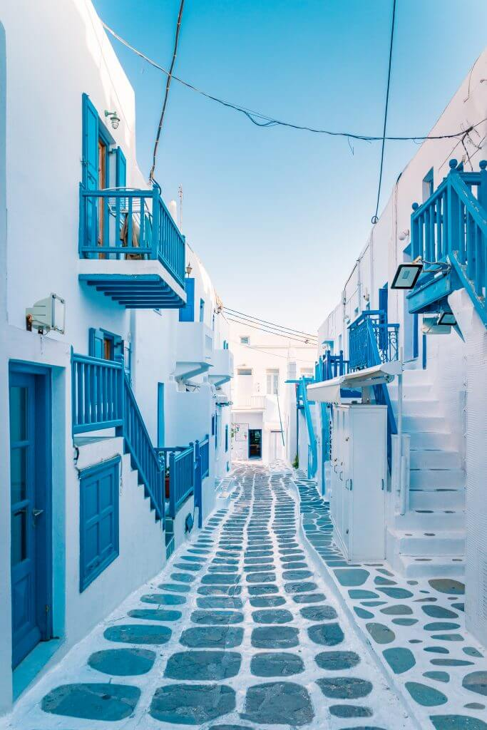 Empty white washed and blue trim street of Mykonos, Greece