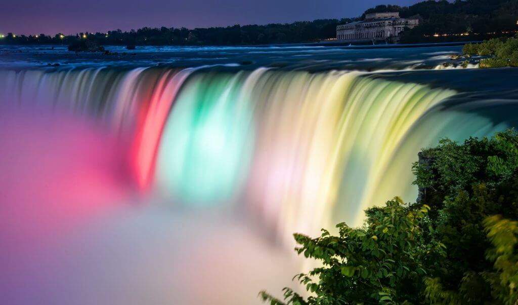 waterfall illuminated with colored lights